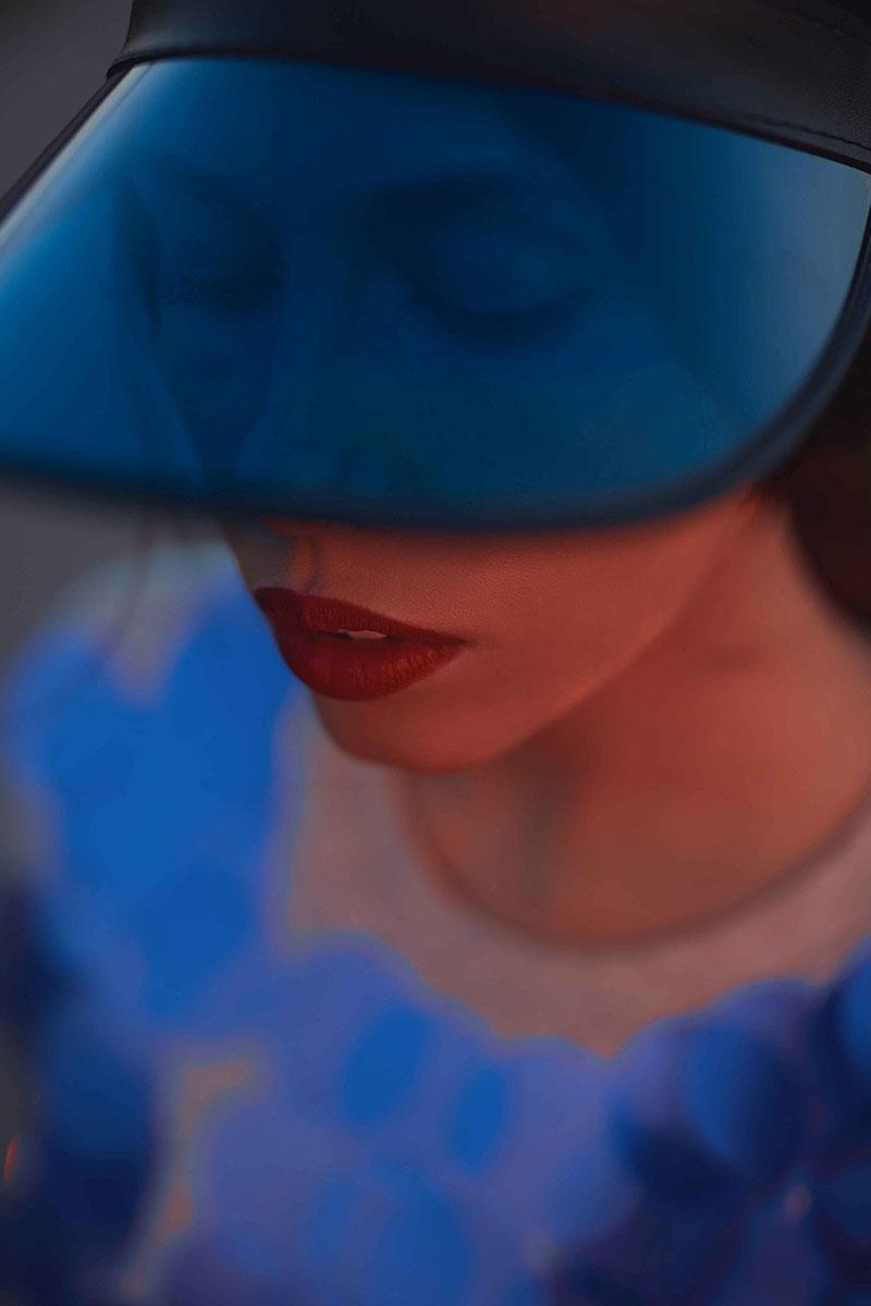 Girl With Blue Visor Cap